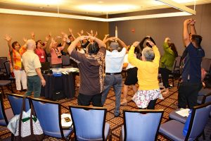 "SG presenters involved attendees in an activity ""Rock Paper Scissors""."